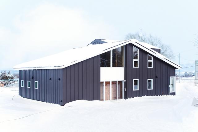 木の温もりある二世帯住宅